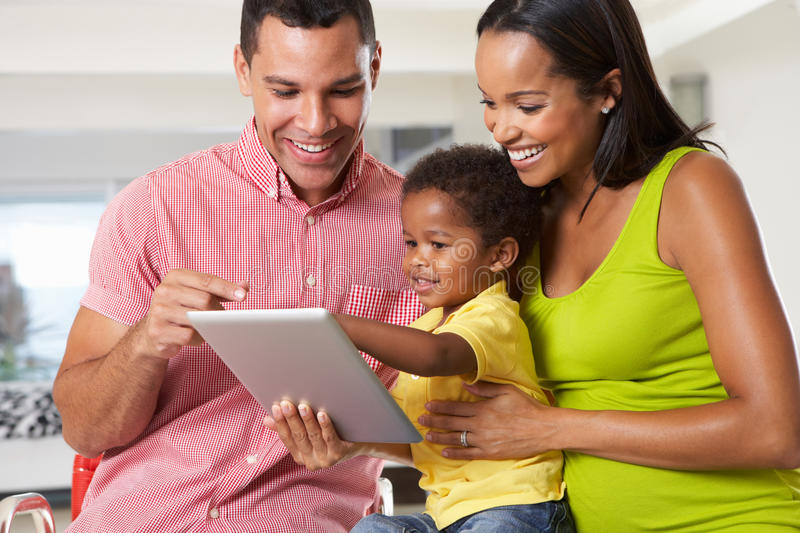 Download Family Using Digital Tablet In Kitchen Together Stock Image - Image: 31164811