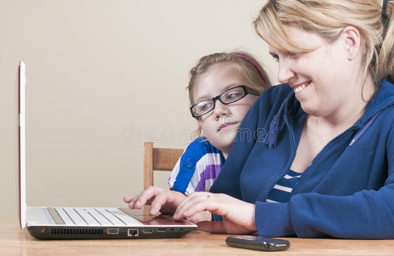 Download Family using a laptop stock photo. Image of color, studying - 24999770