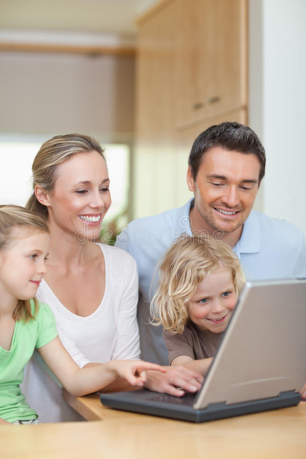 Download Family Using Laptop In The Kitchen Stock Image - Image of activity, laptop: 22661271