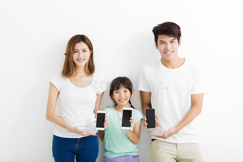 Family using smart phones while standing together. Asian Family using smart phones while standing together royalty free stock photo