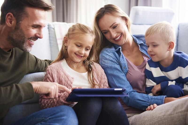 Family using a tablet stock photography
