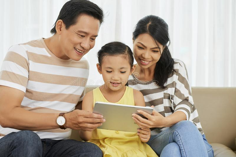 Family using tablet pc at home stock photos