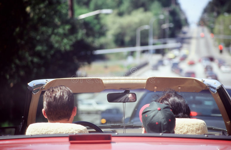 Family on Vacation. Family on vacation traveling in a convertible royalty free stock photo