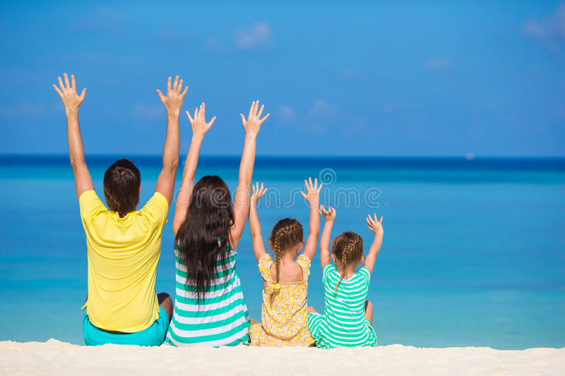 Family vacation on the beach. Happy beautiful family on a beach during summer vacation stock images