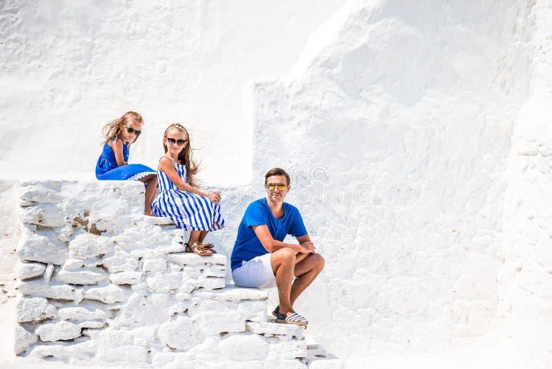 Family having fun outdoors on Mykonos streets stock photo