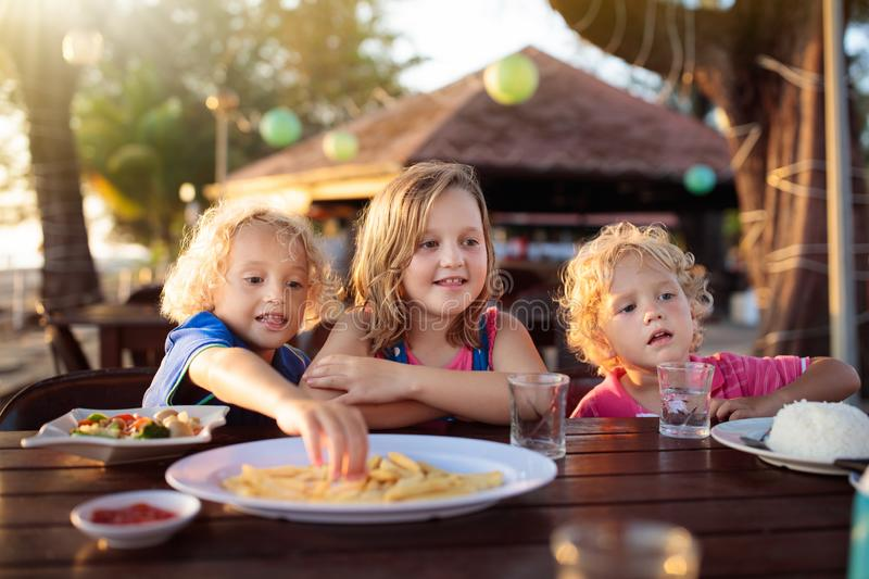 Family vacation lunch. Kids in beach restaurant stock photography