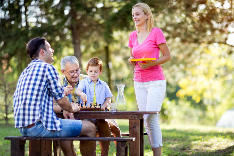 Family vacation. And playing chess royalty free stock photography