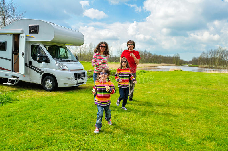 Family vacation, RV (camper) travel in motorhome with kids. Family vacation, RV (camper) travel with kids, happy parents with children on holiday trip in stock photo