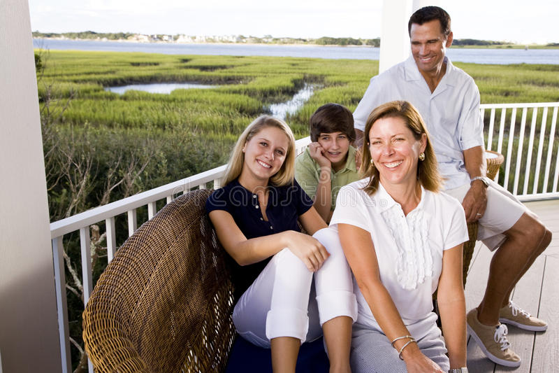 Family on vacation sitting together on terrace stock image