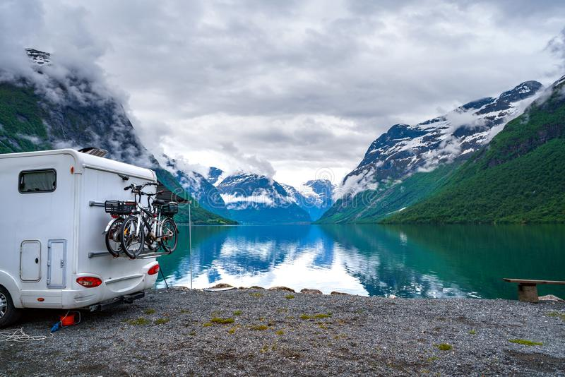 Family vacation travel RV, holiday trip in motorhome. Caravan car Vacation. Beautiful Nature Norway natural landscape