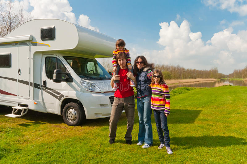 Family vacation trip in motorhome. Family vacation in camping. Happy active parents with kids travel on camper (RV royalty free stock photos