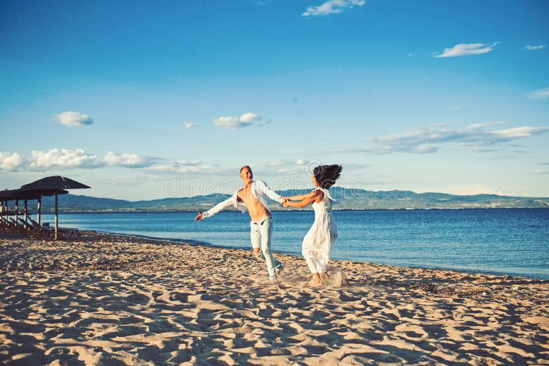 Family and valentines day. Summer holidays and travel vacation. Sexy woman and man at sea. Couple in love dance on beach royalty free stock images