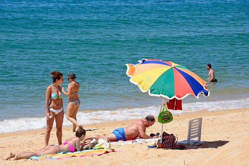 Family on Vilamoura beach, Portugal. stock photography