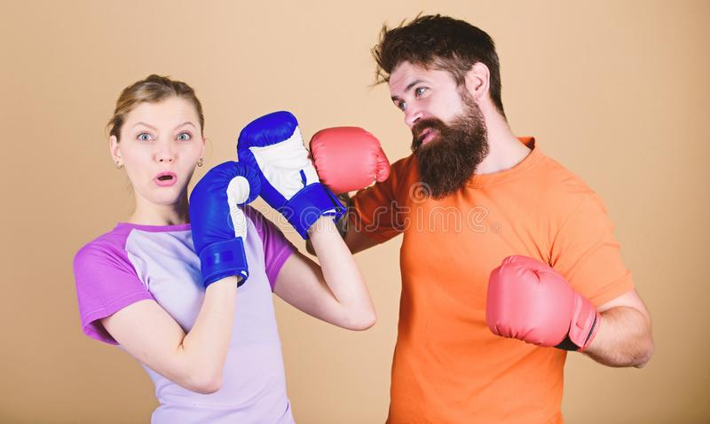 Family violence. Man and woman in boxing gloves. Boxing sport concept. Couple girl and hipster practicing boxing. Sport royalty free stock image