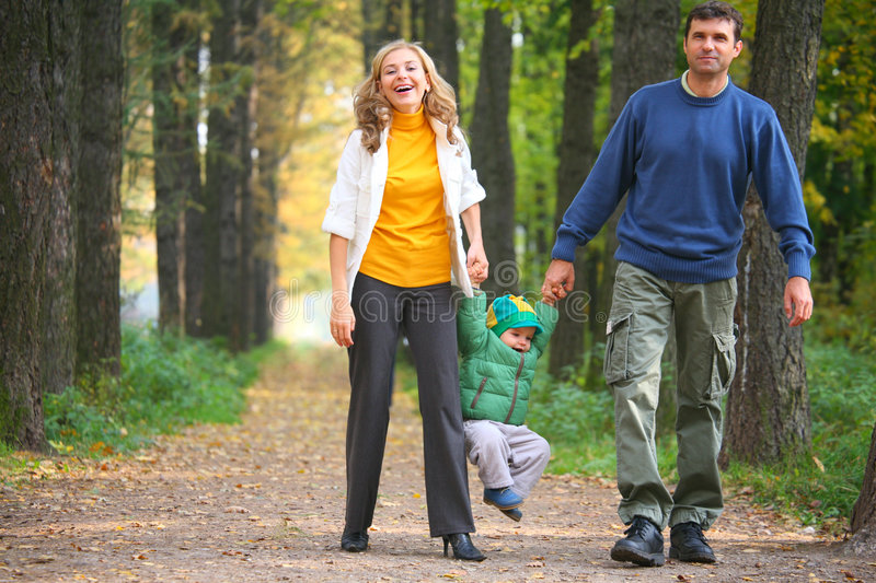 Family on walk. Autumn day stock images