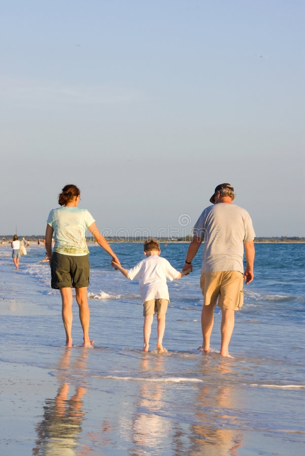 Download Family walk on beach stock image. Image of female, water - 4938651
