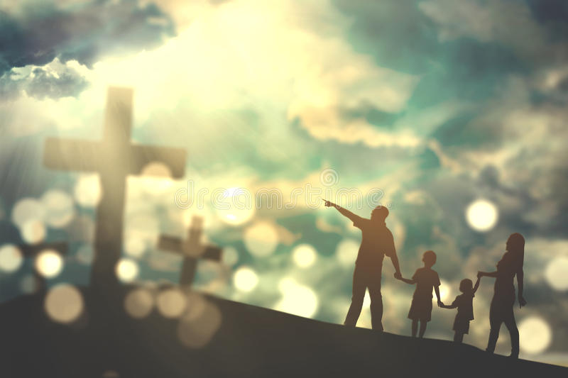 Family walk towards crucifix symbols stock image