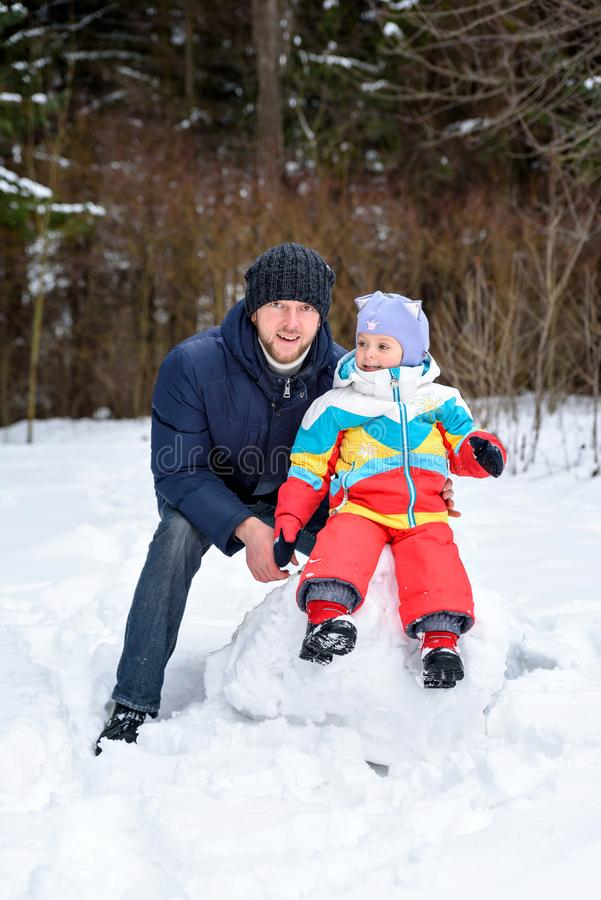 Family walk in winter forest dad mom and child royalty free stock photos
