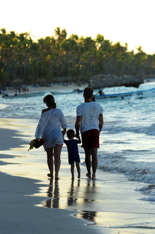 Download Family Walking On A Beach Stock Photos - Image: 5570123