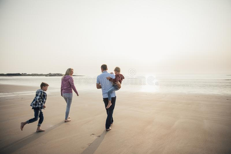 Family Walking at the Beach stock images