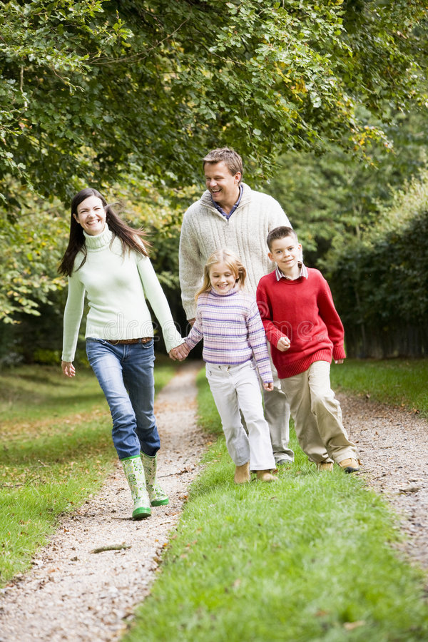 Family walking through countryside royalty free stock photo