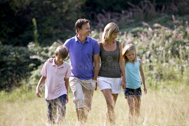 A family walking through a field, close-up stock image