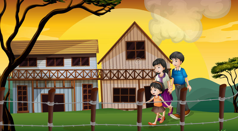 A Family Walking In Front Of The Wooden Houses Royalty Free Stock Image