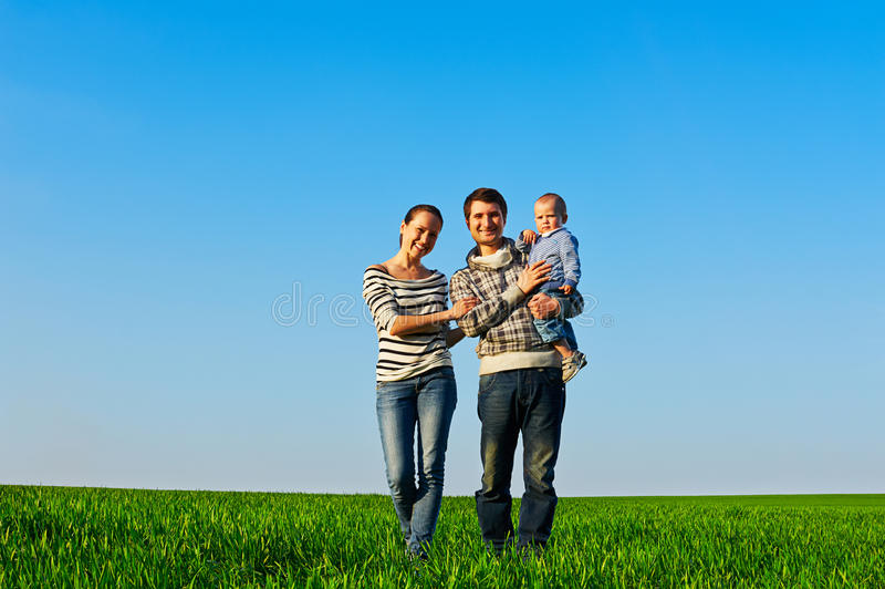 Download Family Walking At The Green Grass Royalty Free Stock Image - Image: 30695156