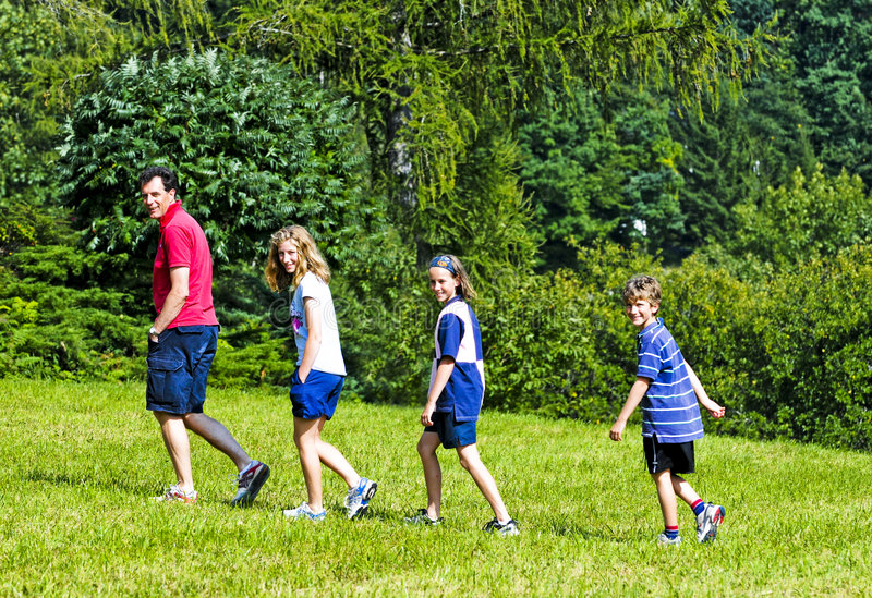 Family walking in the hills stock photography