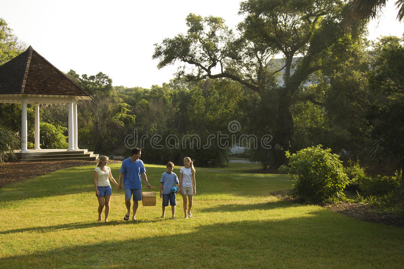 Family walking in park. stock image