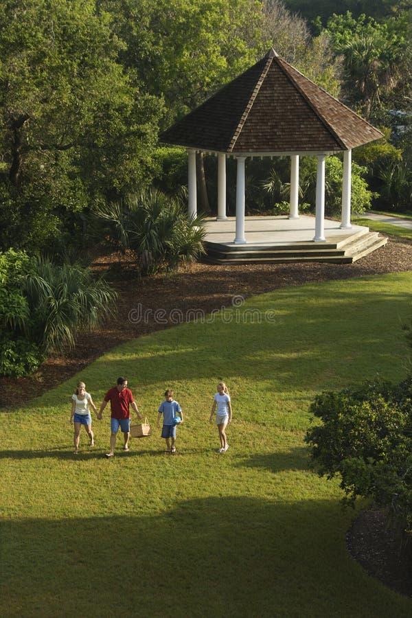 Family walking in park. stock photo