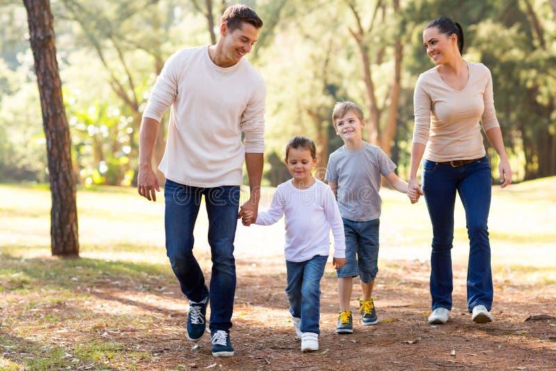 Family walking park royalty free stock photography