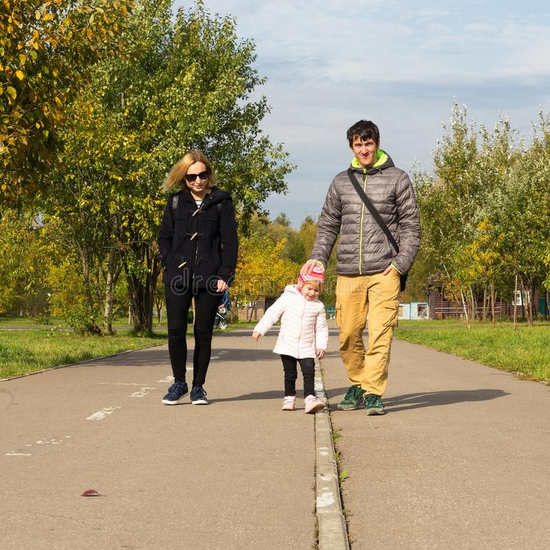 Family walking in a park royalty free stock image