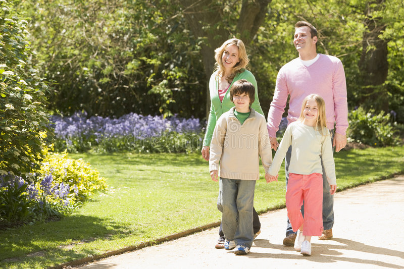 Download Family Walking On Path Holding Hands Smiling Stock Photo - Image: 5935744