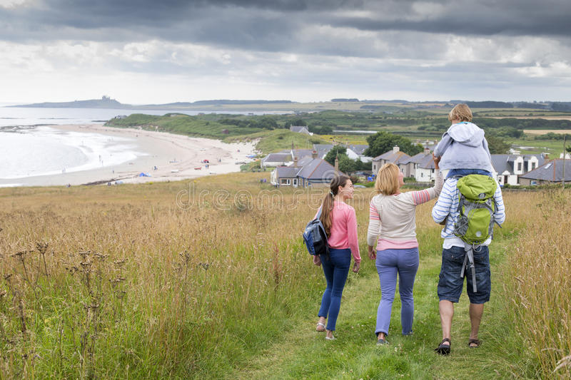 Family walking on the sand dunes royalty free stock photo