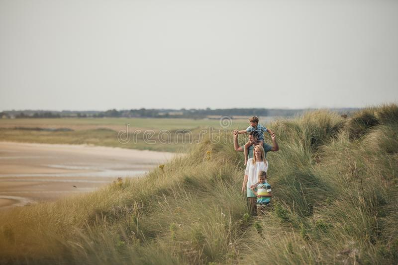 Family Walking Through the Sand Dunes royalty free stock images