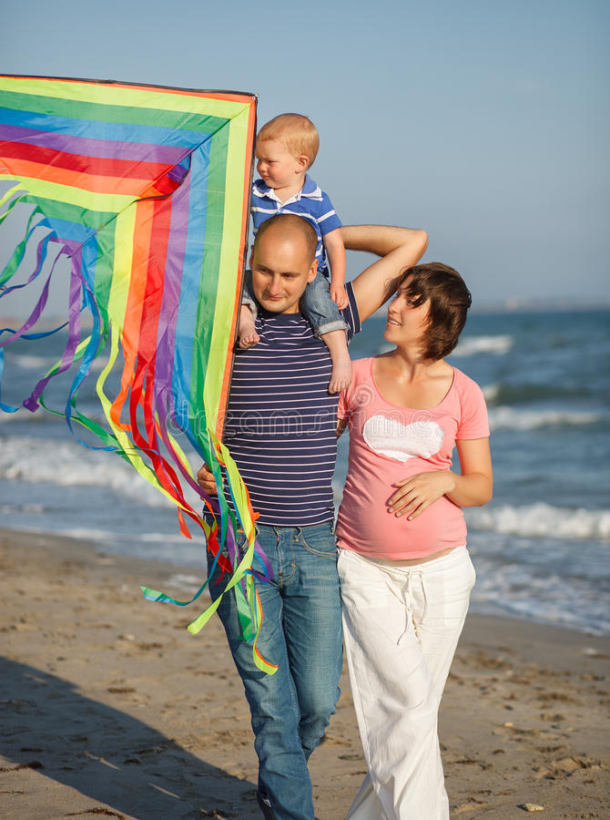 Family walking by the sea. This image has attached release royalty free stock photos