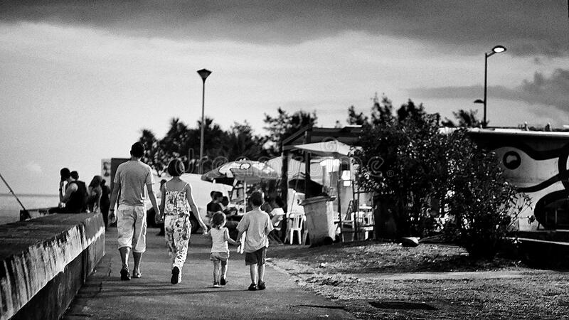 Family walking beside the sea royalty free stock images
