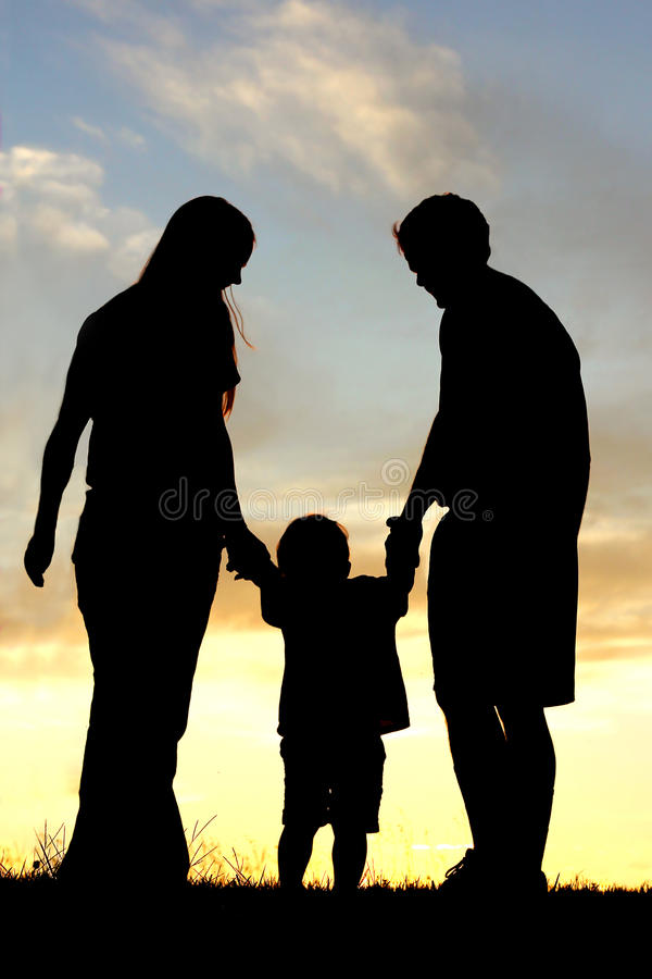 Family Walking at Sunset Silhouette royalty free stock photos
