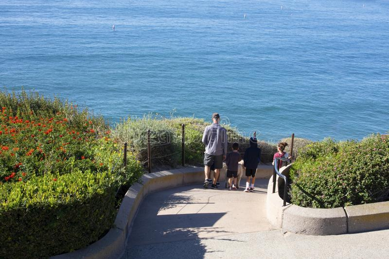Family walking to the ocean. People walking down to the beach. Pacific Ocean, Orange County California stock image