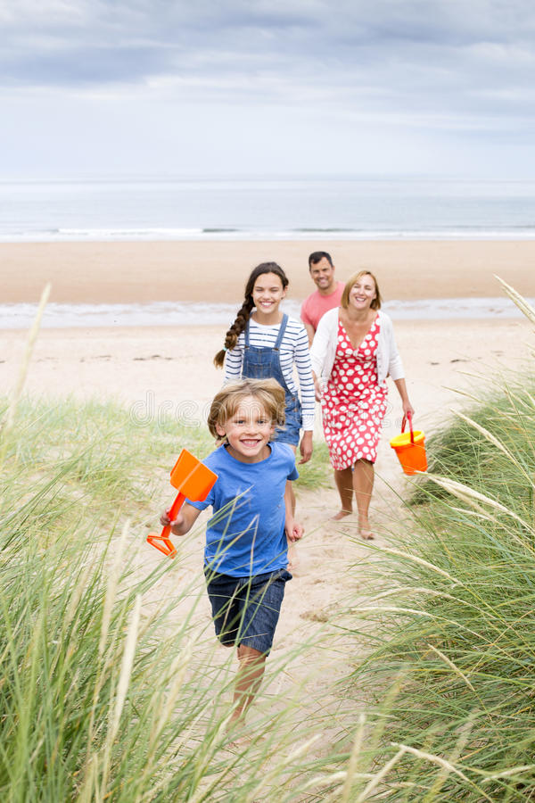 Family walking up the sand dunes royalty free stock photos