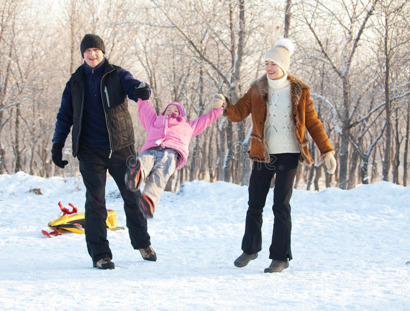 Download Family Walking In A Winter Park Stock Image - Image: 26838417