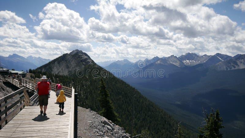 Family walks along a trail on stock photo