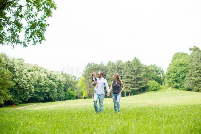 Family walks in park stock image