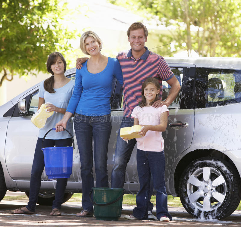 Family Washing Car Together royalty free stock image