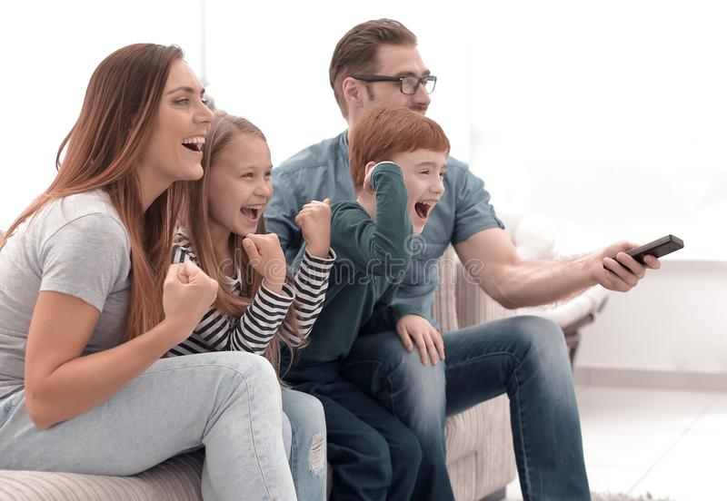 Family watches TV in the modern living room. Free time together royalty free stock photo