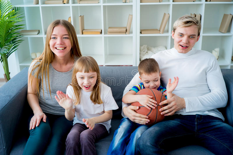 Family watching basketball stock images