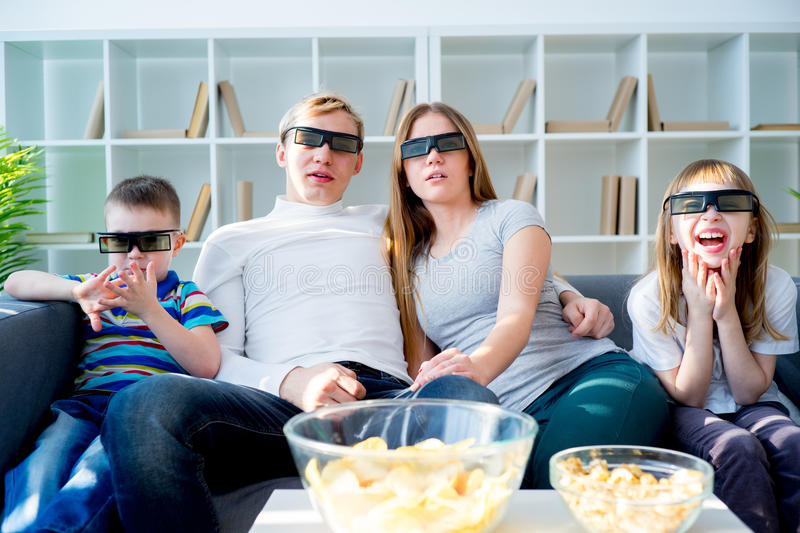 Family watching a 3d movie stock images