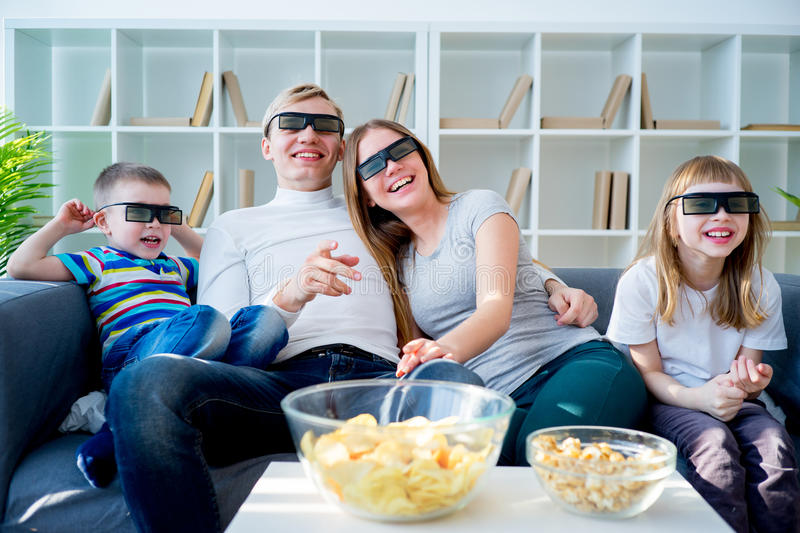 Family watching a 3d movie royalty free stock image