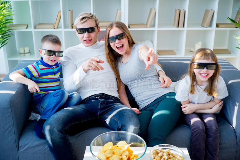 Family watching a 3d movie stock photography
